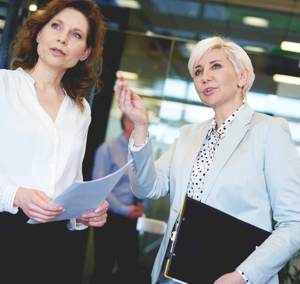 image of two business women talking